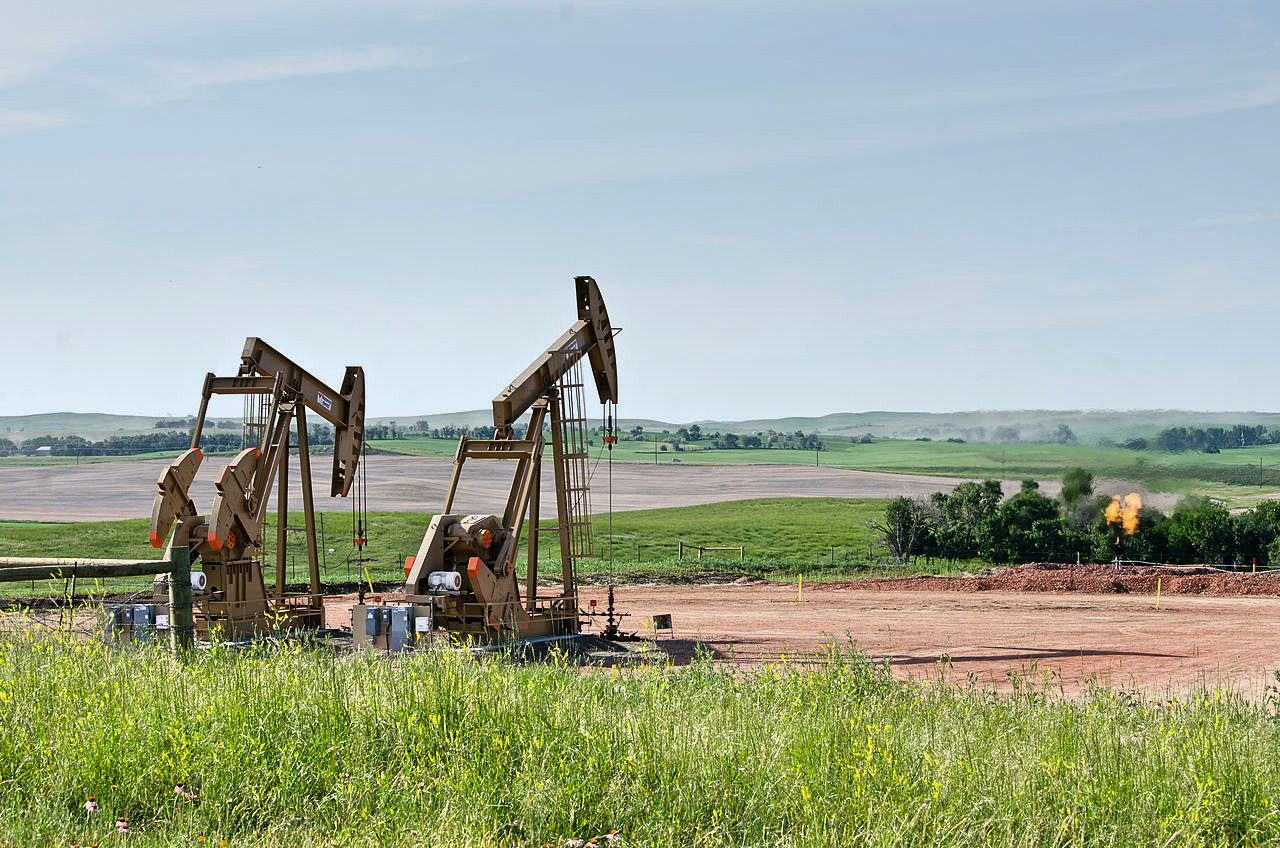 fracking derricks on the plain
