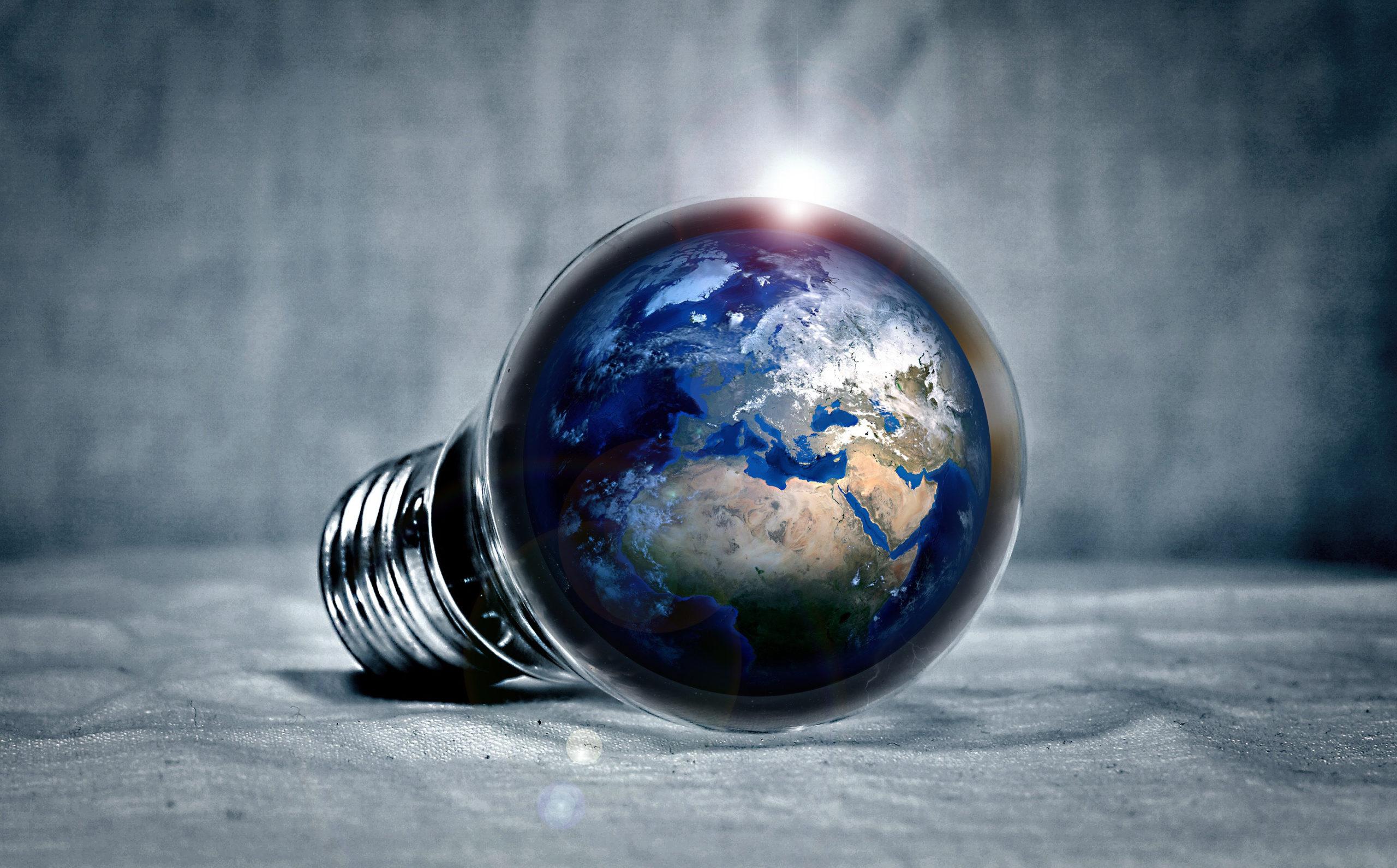 Earth inside a lightbulb. Photo by PIRO4D/Goodfreephotos.com